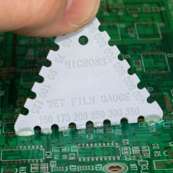 A wet film gauge is a low cost method for measuring coating thickness while the conformal coating is wet. Using the solids content in the material and the wet film thickness allows the dry film thickness to be estimated.