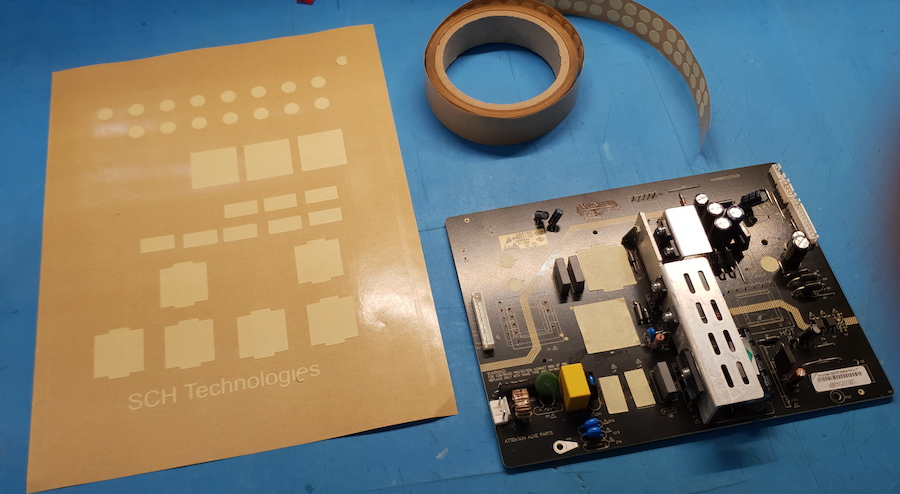 Pre-cut masking tape shapes and roll for conformal coating